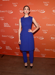 Emmy Rossum looked sharp in a cobalt vest dress by Lela Rose at the Emily's List pre-Oscars brunch.
