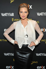 Kate Upton drew attention to her flirty, free-flowing blouse with this large silver circular pendant necklace.