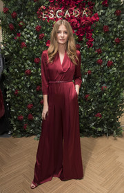Millie Mackintosh looked effortlessly sophisticated in a red cowl-neck satin jumpsuit at the Escada store opening in London.