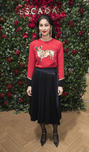 Caroline Issa went playful with this red puppy sweater at the Escada store opening in London.