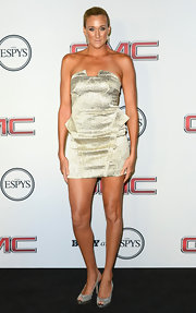 Kerri showed off her totally toned arms with a metallic gold, strapless dress.