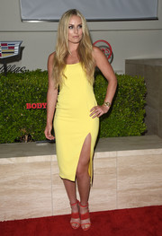 Playing the color-block game, Lindsey Vonn paired her yellow dress with red strappy sandals.