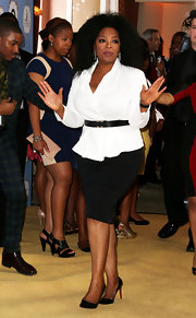 Oprah Winfrey showed her classic style with a white fitted blouse accented with a black belt.