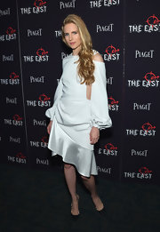 Brit Marling's long-sleeve white dress at the premiere of 'The East' looked conservative at first, until you see the daring cutouts on the sides.