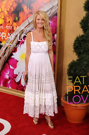 Sandra Lee paired her gold peep toe pumps with a white maxi dress.