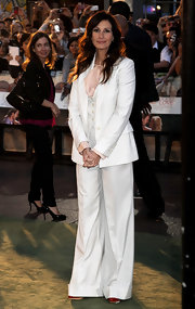Julie showed off her polished menswear style in a white suit.