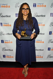 Ava DuVernay teamed her frock with nude suede pumps.