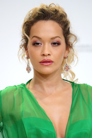 Rita Ora amped up the glam factor with a pair of dangling gemstone earrings.