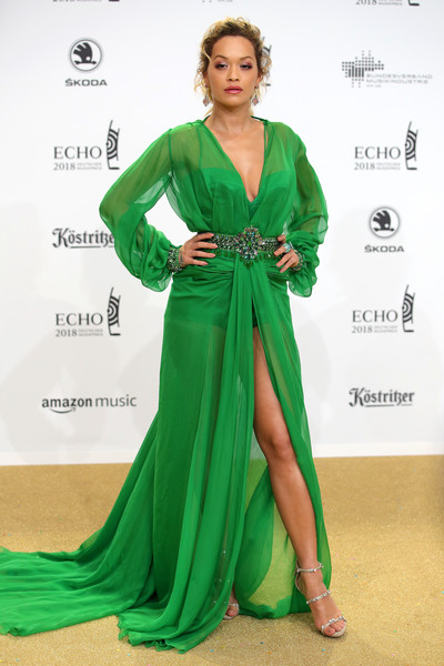 Rita Ora polished off her look with silver triple-strap heels by Giuseppe Zanotti.