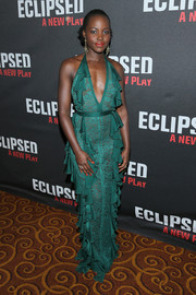 Lupita Nyong'o cut a flirty figure in a plunging green lace and ruffle halter gown by Balmain at the Broadway opening of 'Eclipsed.'