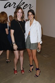 Leandra Medine contrasted her rugged outfit with delicate purple velvet sandals.