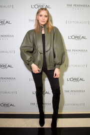 Elena Perminova caught attention with this voluminous olive-green leather jacket at the Editorialist Spring 2016 issue launch.