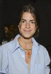 Leandra Medine attended the Edun fashion show wearing a cute and colorful charm necklace.