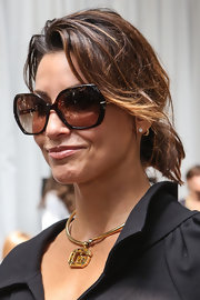 Gina Gershon swept her hair up in a messy yet chic updo at the Edun fashion show.