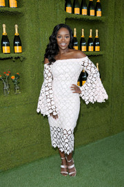 Aja Naomi King finished off her look with a pair of blush-colored triple-strap sandals.