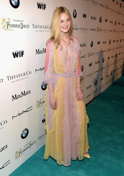 Elle Fanning was eye candy in a boho-chic multicolored maxi dress by Valentino during the Women in Film pre-Oscar cocktail party.