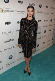 Emily Ratajkowski smoldered at the Women in Film pre-Oscar cocktail party in a Tom Ford sheer-illusion LBD rendered in a zebra pattern against a lace background.
