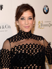 Kate Walsh styled her hair into a tousled ponytail with side-swept bangs for the Women in Film pre-Oscar cocktail party.