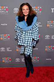 Diane von Furstenberg completed her red carpet attire with dark blue ankle boots.
