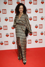 Barbara Wussow wore a gold and black art deco silk gown with a hip-high slit for the Ein Herz Fuer Kinder Charity Gala.