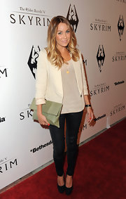 Lauren Conrad kept her minimalist red carpet style on trend with a luxe mint leather clutch.