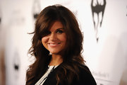 Tiffani Thiessen wore her sexy layered haircut in long, soft waves at the Elder Scrolls V launch.