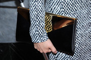 Lucy Liu carried an ultra-stylish black and gold envelope clutch at the 'Elementary' panel during PaleyFest.