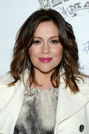 Alyssa Milano looked gorgeous with her tousled waves at the 'Elephant Man' opening.