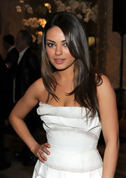 Mila wore her shiny locks in a layered straight style.