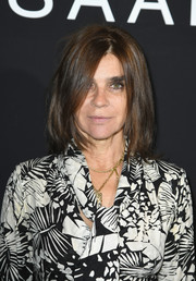 Carine Roitfeld sported a mildly messy lob at the Elie Saab Couture show.