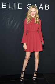Petra Nemcova went for a leggy look in a red mini dress with fluted sleeves during the Elie Saab Couture show.