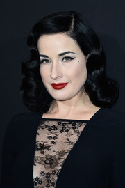 Dita Von Teese came flawlessly coiffed with her signature retro curls to the Elie Saab Couture show.