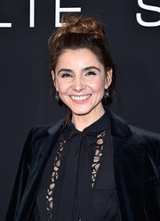 Clotilde Courau wore her hair in a cute top knot at the Elie Saab Spring 2016 show.