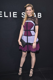 Petra Nemcova embraced color with this plum, lavender, and black lace-panel cocktail dress by Elie Saab when she attended the label's Haute Couture show.