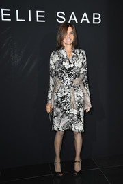 Carine Roitfeld hit the Elie Saab Couture show wearing a classic black-and-white print dress.