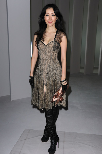 Seia paired her lace embellished dress with leather over-the-knee boots.