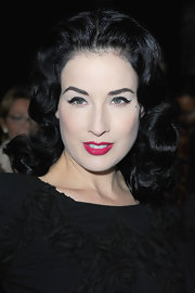 Dita Von Teese showed off her medium curls while sitting front row at the Elie Saab show.
