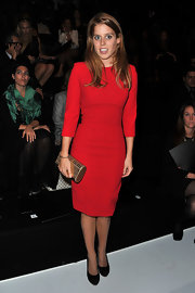 Princess Beatrice donned a vibrant red cocktail dress to the Elie Saab Spring 2012 show. The redhead looked super sophisticated with a gold hard case clutch and black pumps.