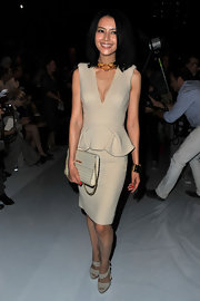 Gao Yuan Yuan attended the Elie Saab Spring 2012 runway show in a crisp nude cocktail dress with a deep-v.