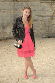 Deborah Francois toughened up her sweet pink frock with a black leather moto jacket for the Elie Saab fashion show.