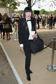 Chantal Thomass worked a masculine vibe in a crisp black tux during the Elie Saab fashion show.