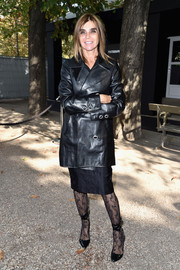Carine Roitfeld looked bold in a black leather coat at the Elie Saab fashion show.
