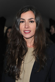 Olivia Ruiz wore her long hair casually styled while attending the Elie Saab fall 2012 fashion show.