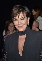 Kris Jenner attended the Elie Saab Fall 2016 show wearing a short 'do with teased bangs.
