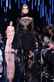 Hailey Baldwin showed off an intricately embroidered, sheer LBD on the Elie Saab runway.