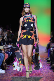 Gold cage booties completed Karlie Kloss' vibrant outfit.