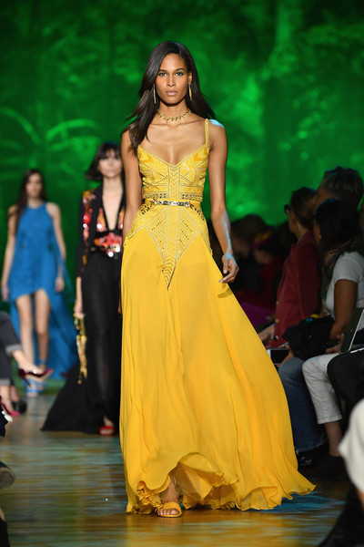 Cindy Bruna dazzled in a canary-yellow gown with a beaded bodice while walking the Elie Saab runway.