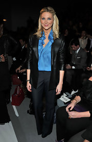 Stephanie rolled up her sleeves at the Elie Tahari fashion show in a black leather blazer over a silk ruffled blouse.