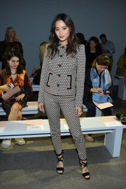 Jamie Chung hit the Elie Tahari fashion show wearing a patterned jacket and pants combo.