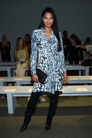 Chanel Iman gave her look a fall-chic vibe with a pair of black thigh-high boots.